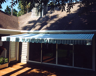have a covered deck and sundeck in one space with retractable awnings